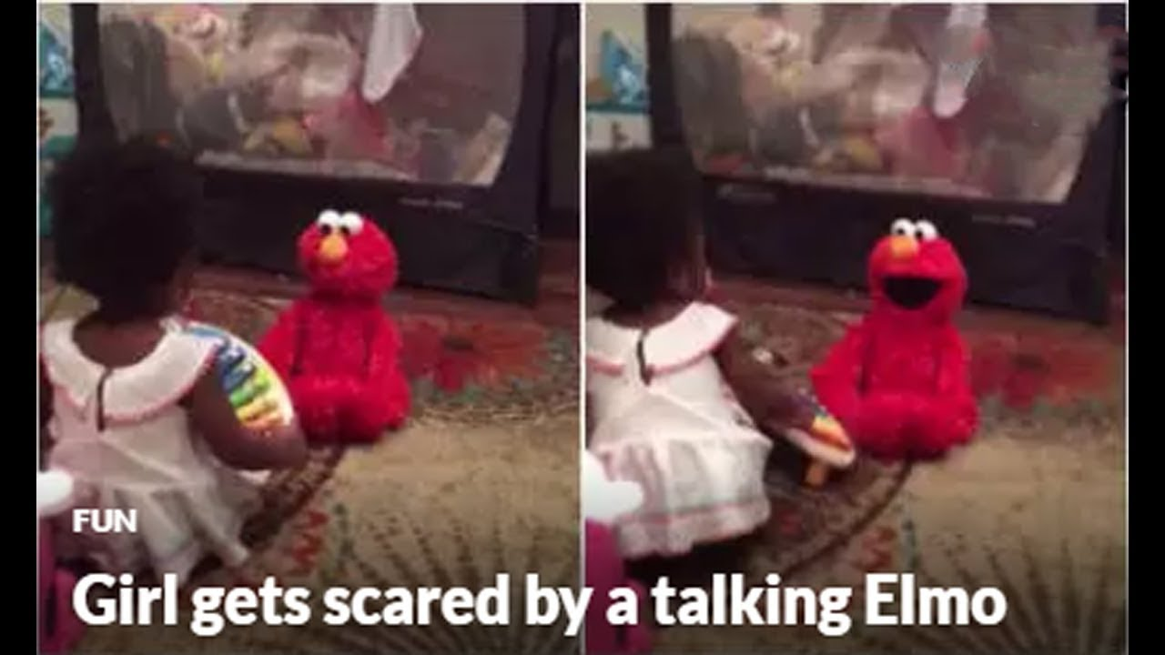 Girl Gets Scared By A Talking Elmo