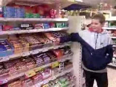 kid pulls tesco stuff off shelf