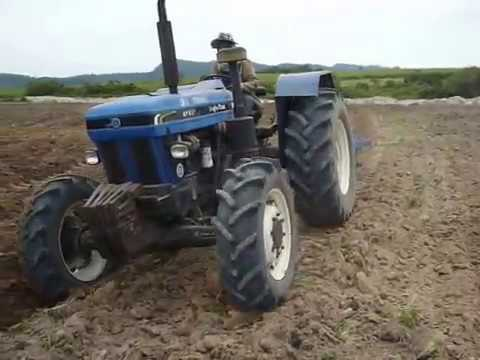 Ford New Holland 6610, Attachment 4 disc plough AT6610 4con