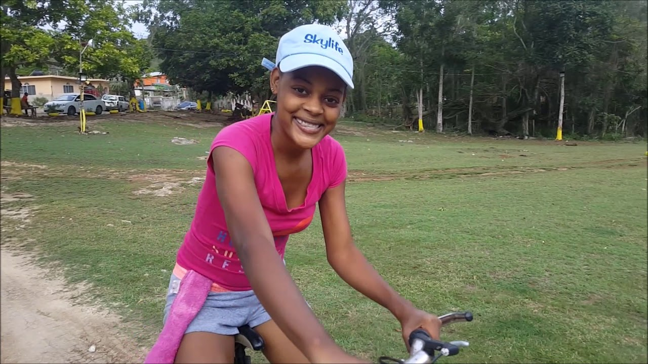 Jamaican girls ridding bikes