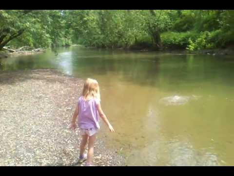 Grace Throwing Rocks into the Tuscarawas River