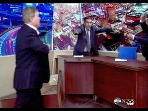 Man Pulls Out Gun on TV