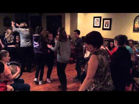 Trad Youth Exchange musicians enjoy ceili dancing at Harrington's