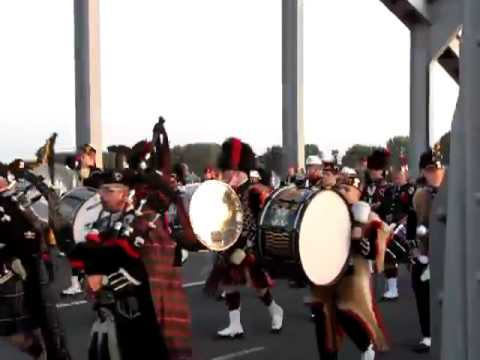 slow march massed pipes and drums, John Frost bridge, Arnhem.