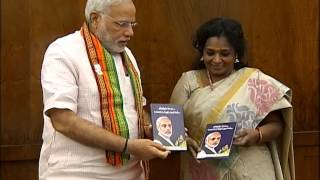 Dr. Tamilisai Soundararajan presented a book to PM Modi