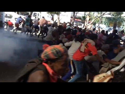 Police fire stun grenades to disperse protesters at Cape Town taxi rank