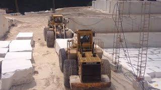 Komatsu WA800 And Cat 992B Wheel Loaders Carrying Together A Huge Marble Block
