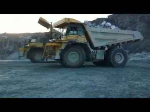 Dumping stones into the shaft, Bremanger Quarry - YouTube