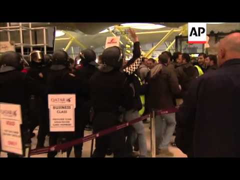 Striking airline staff inside airport terminal, reaction from customers