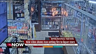 New video shows man setting fire to liquor store