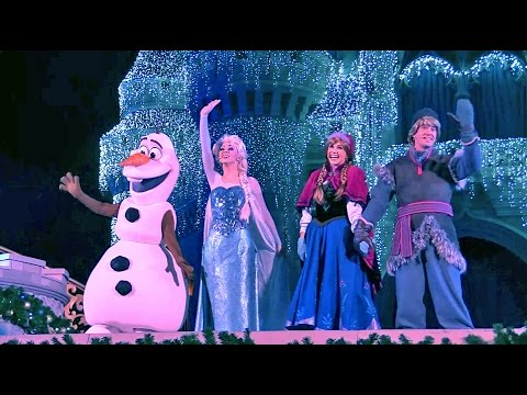 Frozen Holiday Wish castle lighting show debut - Elsa, Anna, Olaf, Kristoff at Walt Disney World