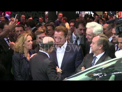 Arnold Schwarzenegger goes from stand to stand at International Car Show in Paris