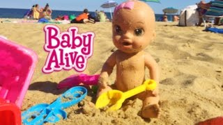 BABY ALIVE GOES TO THE BEACH & SWIMS IN OCEAN!