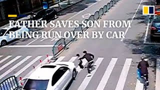 At last minute, father saves son from being run over by car in China