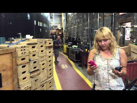 Film set production assistant doing her job