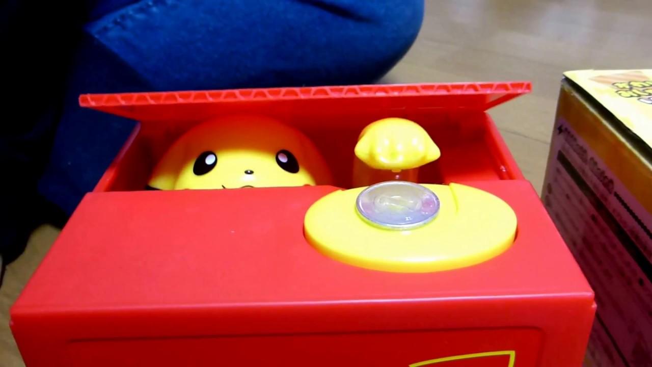 ピカチュウバンク pokemon pikachu piggy bank 箱の中にコインを引き込む