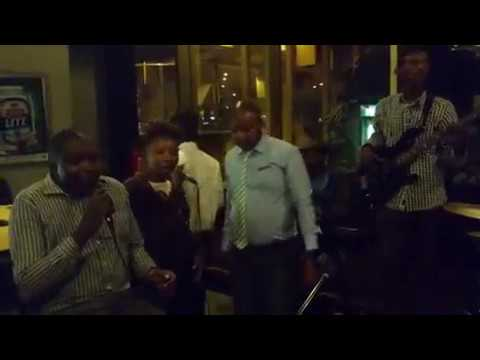 Mjae and Patron Performing Redemption Song at Karaoke Night Rainbow Towers Harare,