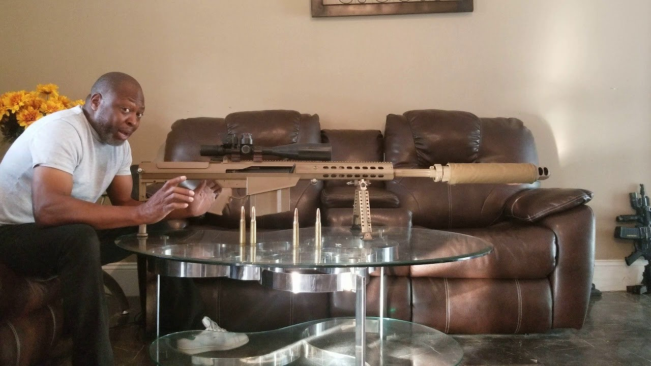 SHOOTING THE BARRETT 50CAL. INSIDE MY HOUSE ON A GLASS TABLE!!!!!!