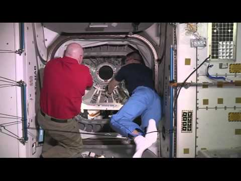 Crew of the International Space Station open hatch to Cygnus spacecraft