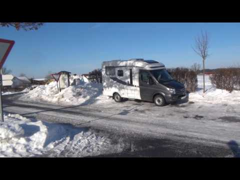 Snowy winter morning in the van in Germany