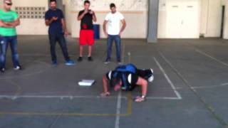 Guiness world record of fastest push-ups in 1 min with 40 lb weight on the back