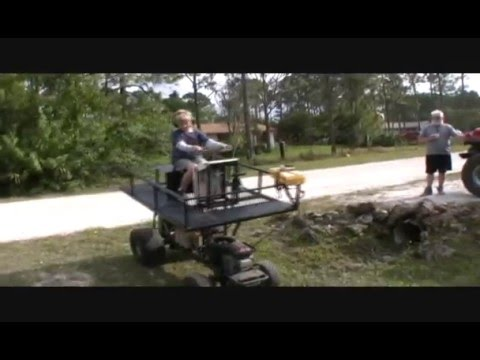 swamp buggy made from lawnmower.wmv