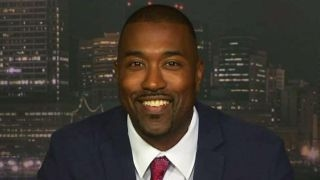Tucker vs prof who says DeVos represents 'white power'