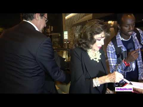 Joan Collins and Beau Percy Gibson Leaving Craig's Restaurant In LA.