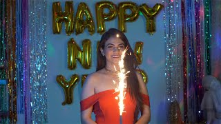 Young beautiful girl smiling with fire sparklers during New Year celebration in India