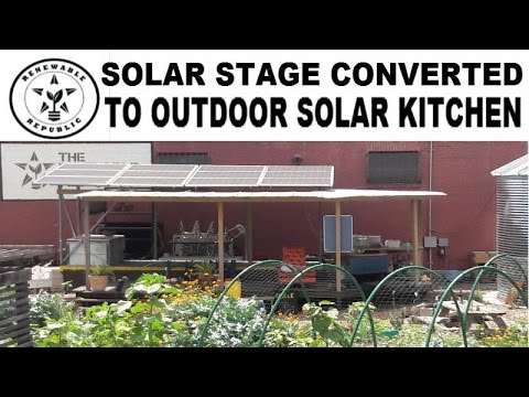RENEWABLE REPUBLIC MOBILE SOLAR STAGE CONVERTED INTO OUTDOOR SOLAR KITCHEN SOLAR POWERED PV PANELS