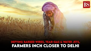 Defying barbed wires, tear-gas & water jets, farmers inch closer to Delhi
