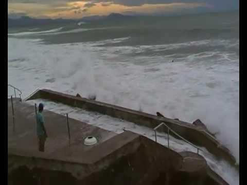 Dangerous: Biarritz high tide big waves - guy in sea
