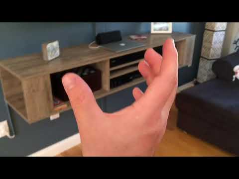 How to hang wall mounted entertainment center