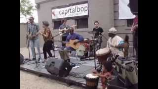 D-Dog drumming with Malian musicians at the Funk Parade in DC