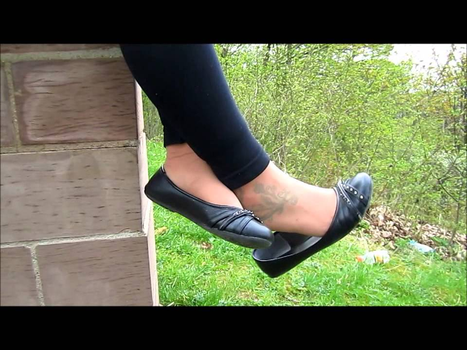 dangling black flats with nylons