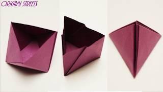 Оригами коробка пирамиды из бумаги.