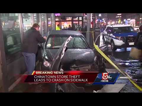 Stolen car hits woman, crashes into drug store in downtown Boston