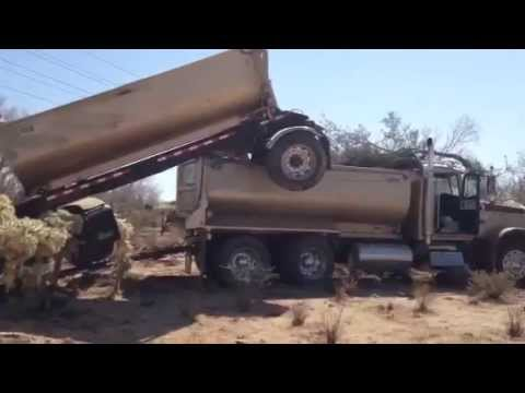 Video: Driver crashes tandem dump truck NW of Tucson - YouTube