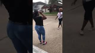 Two large black ladies fight