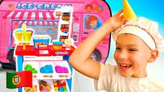 Vania brincam de conta que tem uma loja de sorvete