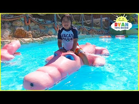 Ryan plays at Water Park and rides Water Slides for kids