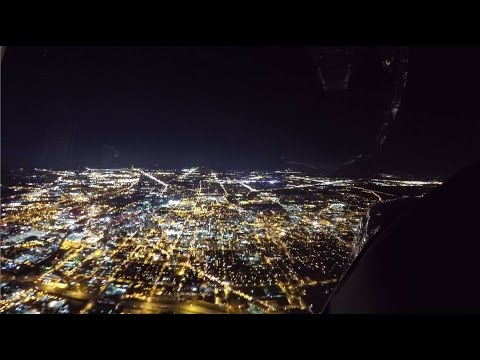 Time Lapse approaching Indianapolis with Downtown and Indianapolis Motor Speedway flyover