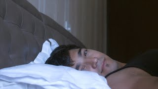 Extreme close up shot of man waking up from sleep in the bed, early morning - daily routine