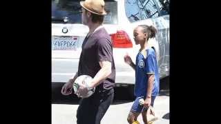Angelina Jolie picks up ice cream while cheering on Shiloh and Zahara at their soccer game with Brad