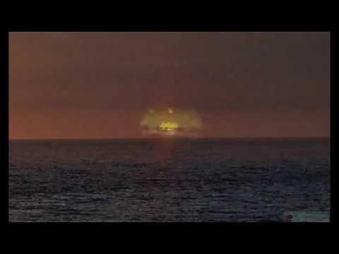Golden UFO Photographed Entering Undersea Base