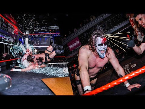 Mikey Whiplash puts Jimmy Havoc through a sheet of glass!