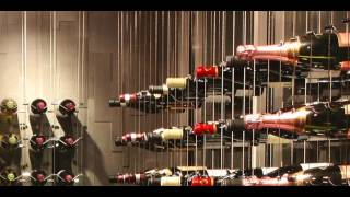 Modern Wine Cellar featuring Cable Wine System, 'Basement Design with Increased Horizontal Spacing'