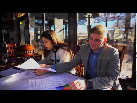 Young architects creating new project at cafe table