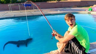 FISHING IN SWIMMING POOL!! (POND MONSTER)