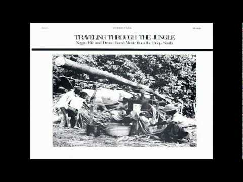 Traveling Through Jungle Fife & Drum Bands - marchin in